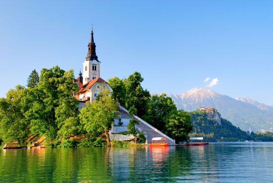 St Martin church on island and Bled lake landscape in Slovenia